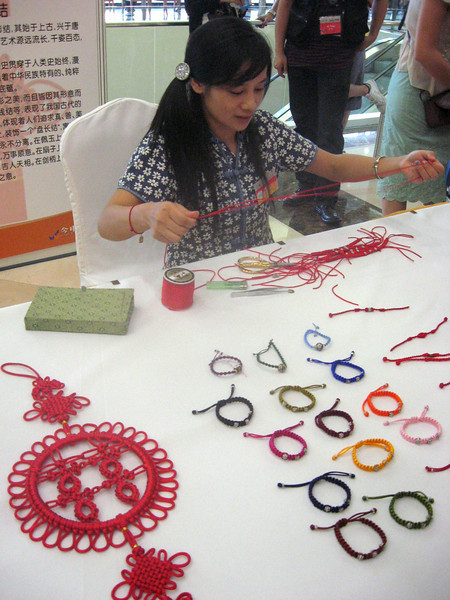 During a break, a demonstration of Chinese Knotting