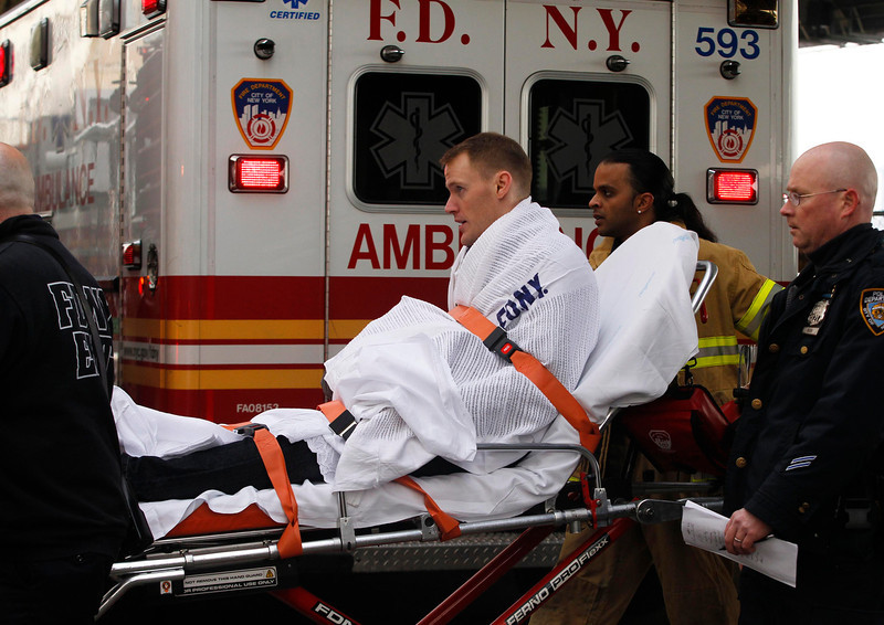 . A victim of a commuter ferry crash is cared for by an FDNY EMT on the scene in New York, January 9, 2013. A commuter ferry crashed into a pier in lower Manhattan early Wednesday, injuring 57 people, one critically, the New York City Police Department said. Passengers lying on stretchers littered the pier near South Street Seaport, attended to by firefighters and rescue workers who rushed to the scene of the 8:43 a.m. (1343 GMT) hard landing.  REUTERS/Brendan McDermid