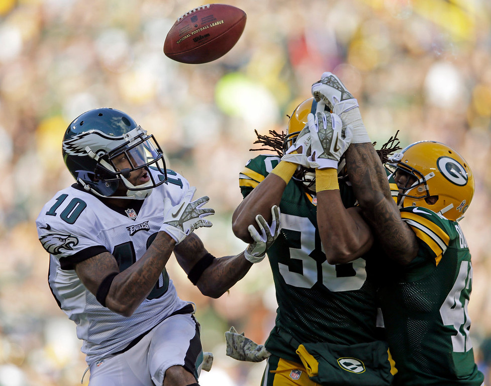 . Philadelphia Eagles\' DeSean Jackson (10) catches a touchdown pass off the deflection of Green Bay Packers\' Tramon Williams (38) and Morgan Burnett during the first half of an NFL football game Sunday, Nov. 10, 2013, in Green Bay, Wis. (AP Photo/Tom Lynn)