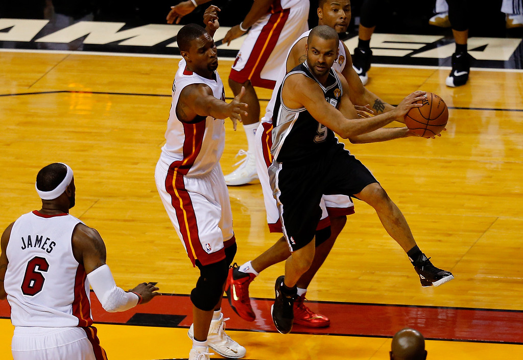 . MIAMI, FL - JUNE 12: Tony Parker #9 of the San Antonio Spurs looks to pass as Chris Bosh #1 of the Miami Heat defends during Game Four of the 2014 NBA Finals at American Airlines Arena on June 12, 2014 in Miami, Florida. (Photo by Chris Trotman/Getty Images)