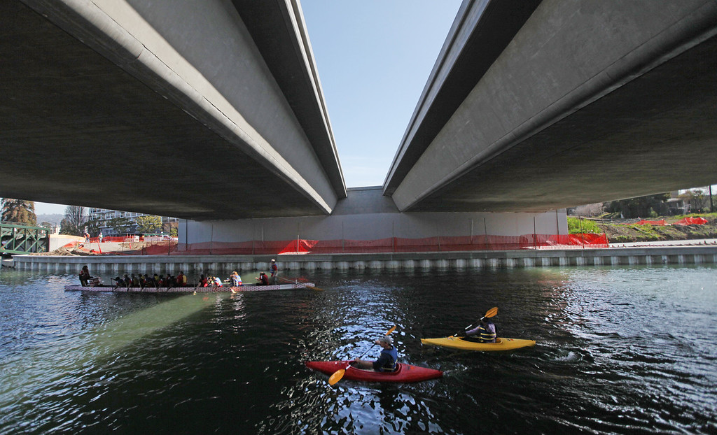 . Kayakers float on the channel under the new 12th Street bridge as they wait for the celebration of the re-opening of a 750-foot section of the  Lake Merritt Channel to begin in Oakland, Calif., on Friday, Feb. 22, 2013. The new 100-foot-wide free flowing tidal channel, for the first time since 1869, allows boats to travel from the Lake Merritt Channel to Lake Merritt . This is the first of a series of projects that will eventually connect Lake Merritt to the Oakland Estuary. (Laura A. Oda/Staff)