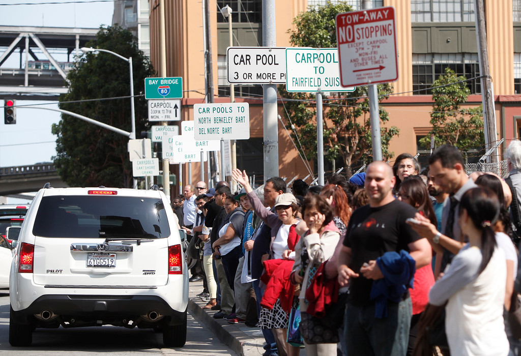 . Casual carpoolers await their ride at marked stops along Beale Street in downtown San Francisco, Calif., on the first day of the BART strike late Monday afternoon, July 1, 2013. (Karl Mondon/Bay Area News Group)