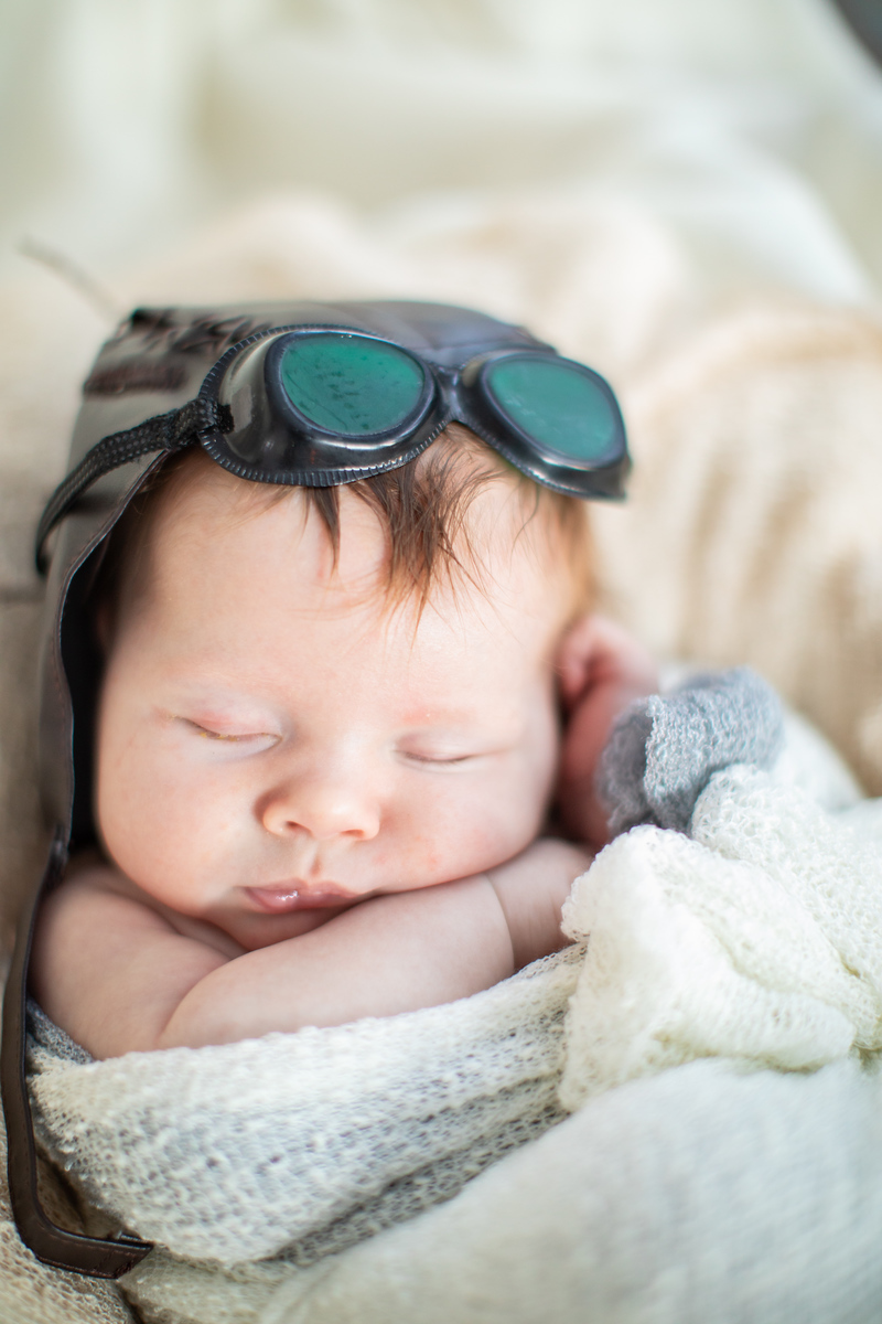 Washington DC newborn photographer Jalapeno Photography features baby Amelia's photos. This photo is of the beautiful baby in a pilot outfit.
