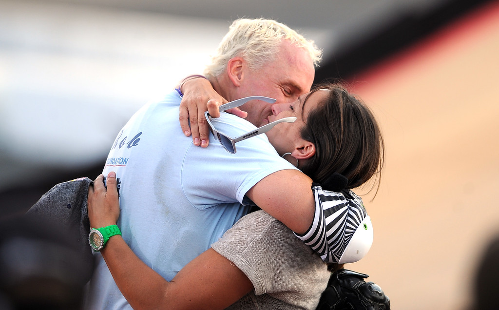 . Kevin Robinson hugs his wife Robin after finishing sixth in his final ride of his career during the GoPro BMX Big Air Final at Irwindale Speedway on Friday, Aug. 2, 2013 in Irwindale, Calif. Morgan Wade won the gold medal.  (Keith Birmingham/Pasadena Star-News)