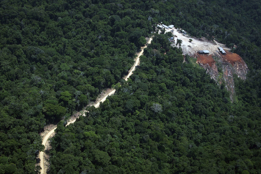 """. View of the so called Odani sawmill during an overflight by Greenpeace activists over areas of illegal exploitation of timber, as part of the second stage of the \""""The Amazon\'s Silent Crisis\"""" report, in the state of Para, Brazil, on October 14, 2014. RAPHAEL ALVES/AFP/Getty Images"""