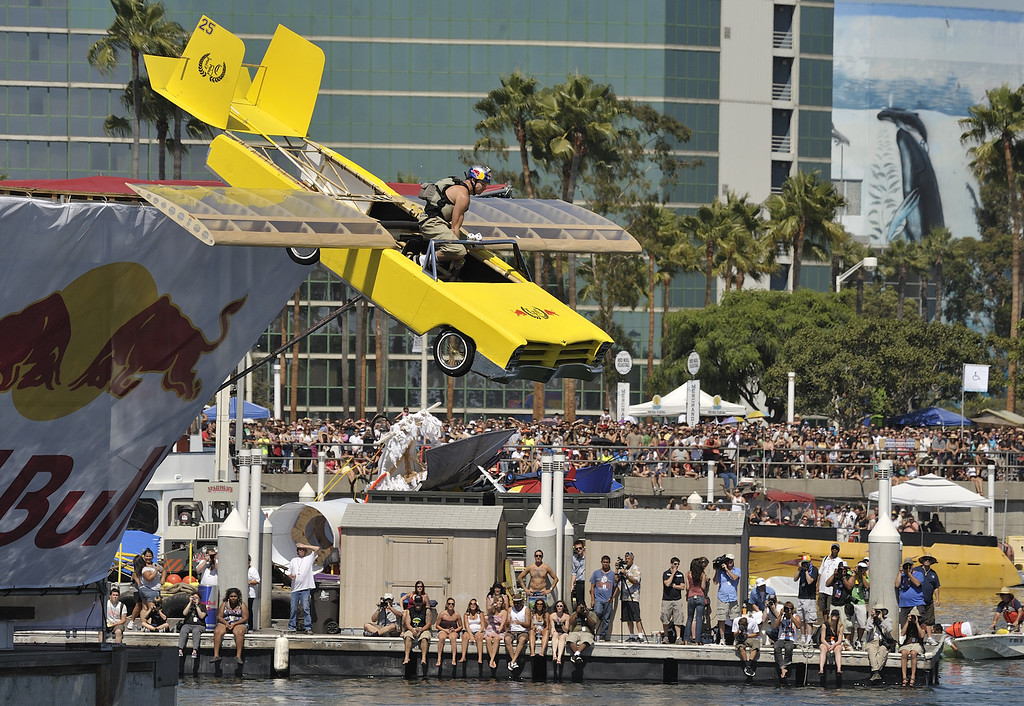 """. LONG BEACH, CALIF. USA -- Nate Julson pilots his team\'s Flugtag entry \""""Ridin\' in the G-funk Era\"""" in Rainbow Harbor in Long Beach, Calif. on August 21, 2010. Thirty five teams competed in the Red Bull event where teams build homemade, human-powered flying machines and pilot them off a 30-foot high deck in hopes of achieving flight.  Flugtag means \""""flying day\"""" in German. They are on distance, creativity and showmanship..Photo by Jeff Gritchen / Long Beach Press-Telegram.."""