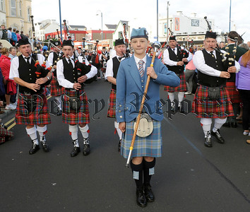 Bessbrook Crimson Arrow Pipe Band pictured on parade through the packed streets of Portrush following the North West Pipe Band Championships on Saturday 23rd August.