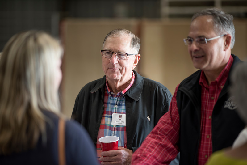 Lance Tennis (center) enjoys a conversation at the Alumni Spring Barbecue that is held at the University Farm on Thursday, April 27, 2017, in Chico, Calif.  (Jessica Bartlett/ Photographer)