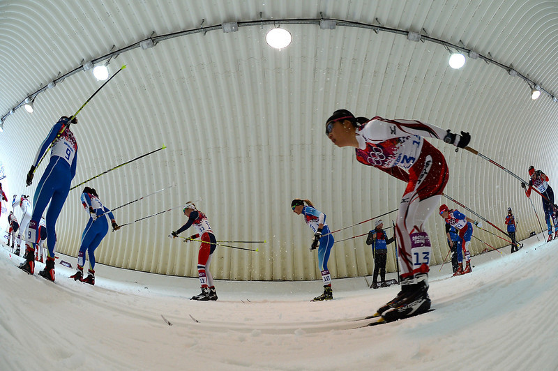 . Skiers compete in the Women\'s Cross-Country Skiing 7,5km + 7,5km Skiathlon at the Laura Cross-Country Ski and Biathlon Center during the Sochi Winter Olympics on February 8, 2014 in Rosa Khutor.    (KIRILL KUDRYAVTSEV/AFP/Getty Images)