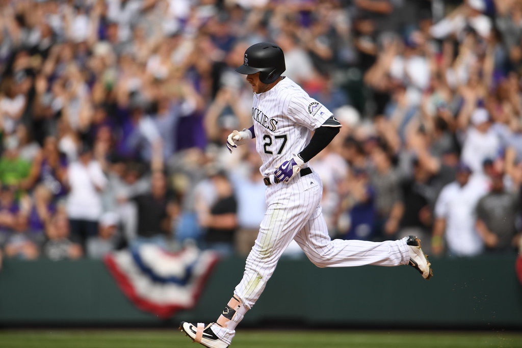 . Trevor Story (27) of the Colorado Rockies runs the bases after hitting a home run during the fourth inning. The Colorado Rockies played the San Diego Padres Friday, April 8, 2016 on opening day at Coors Field in Denver, Colorado. (Photo By RJ Sangosti/The Denver Post)