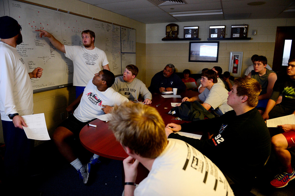. Valor Christian starting center Cody Bratten explains a strategy to teammates during an offensive line meeting.  (Photo by AAron Ontiveroz/The Denver Post)