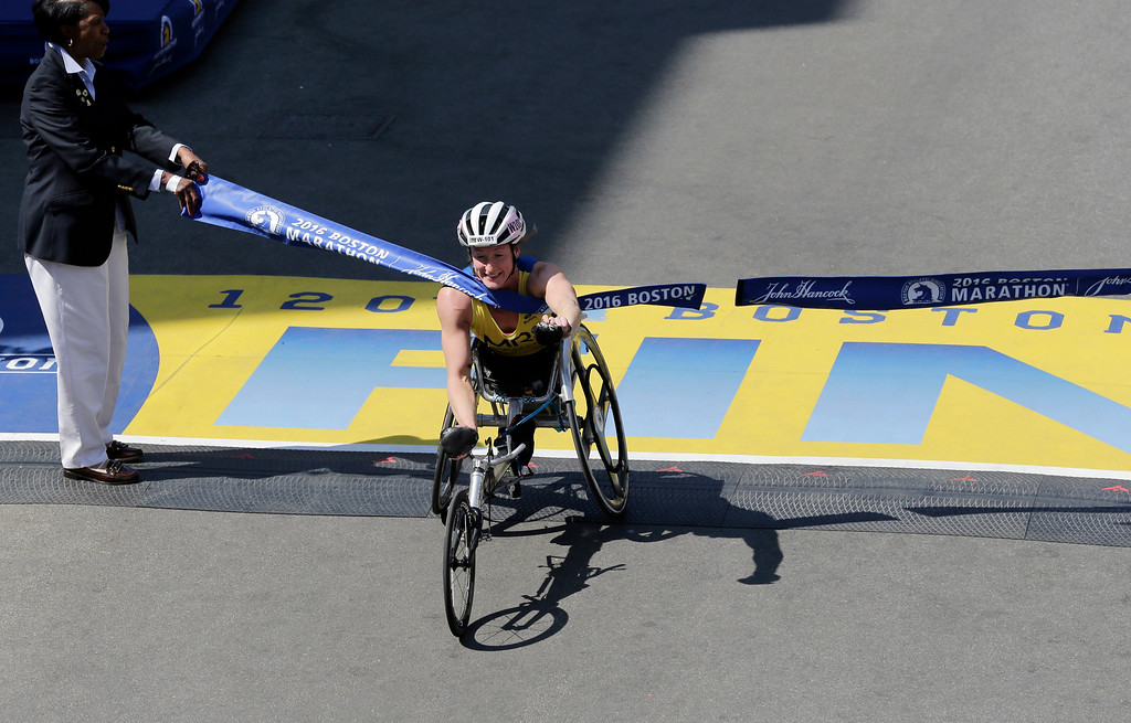 . Tatyana McFadden, of Clarksville, Md., breaks the tape to win the women\'s wheelchair division of the 120th Boston Marathon on Monday, April 18, 2016, in Boston. (AP Photo/Charles Krupa)
