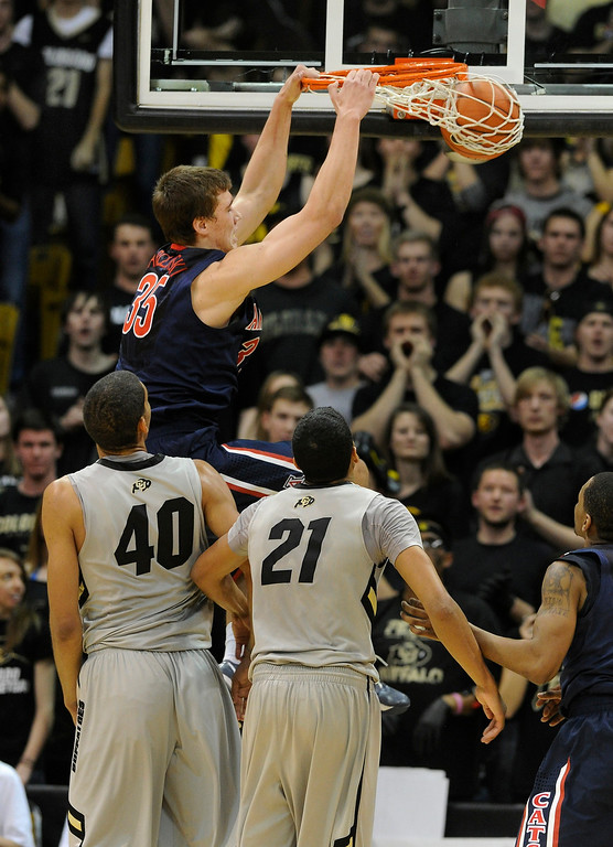 . BOULDER, CO. - FEBRUARY 14: Arizona Wildcats center Kaleb Tarczewski (35) jammed a shot through the net in the second half. The University of Colorado men\'s basketball team defeated Arizona 71-58 Thursday night, February 14, 2013 at the Coors Event Center in Boulder. (Photo By Karl Gehring/The Denver Post)