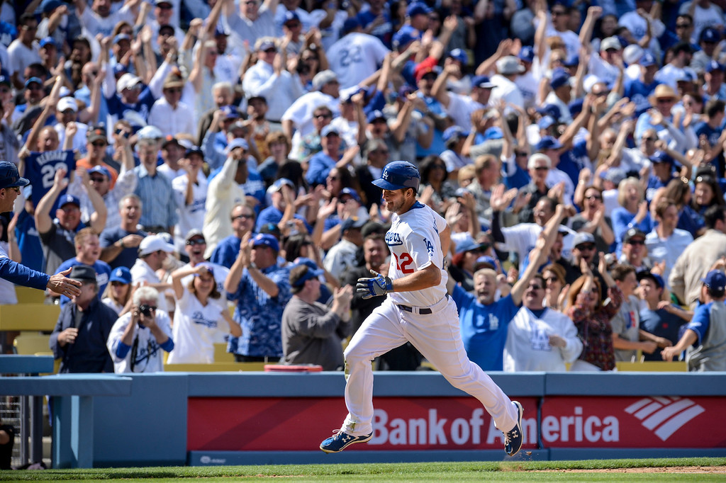 . Dodger\'s Clayton Kershaw rounds the bases after hitting a home run in the 8th inning during opening day at Dodger Stadium Monday.  Dodgers defeated the Giants 4-0.  Photo by David Crane/Los Angeles Daily News.