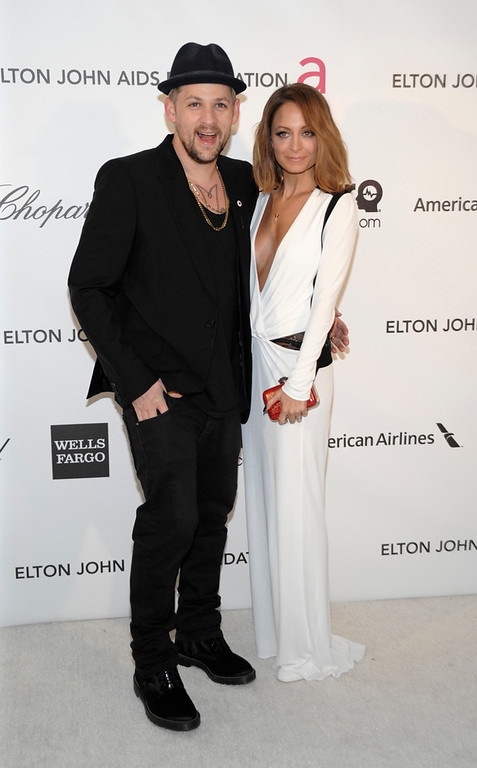 . Television personality Nicole Richie, right, and musician Joel Madden arrive at the 2013 Elton John Oscar Party in West Hollywood, Calif. on Sunday, Feb. 24, 2013. (Dan Steinberg/Invision/AP)