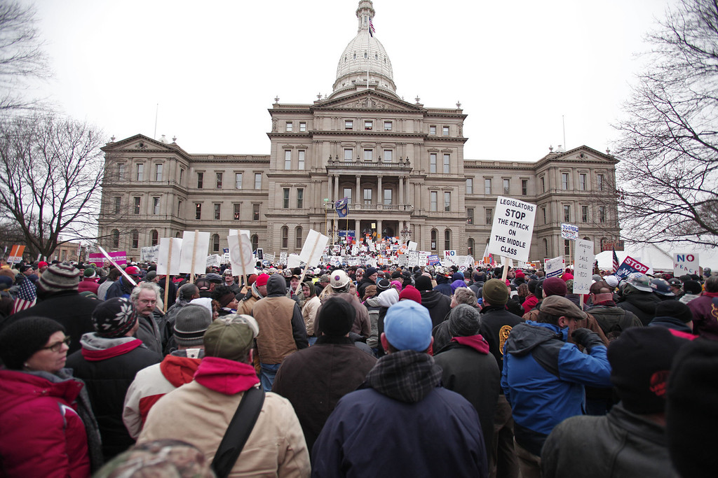 . Union members from around the country rally at the Michigan State Capitol to protest a vote on Right-to-Work legislation December 11, 2012 in Lansing, Michigan. Republicans control the Michigan House of Representatives, and Michigan Gov. Rick Snyder has said he will sign the bill if it is passed. The new law would make requiring financial support of a union as a condition of employment illegal. (Photo by Bill Pugliano/Getty Images)
