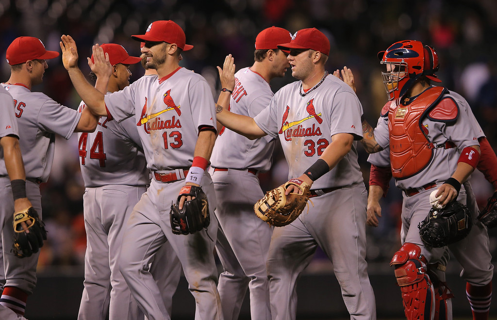 . The St. Louis Cardinals celebrate their 8-0 lead over the Colorado Rockies at Coors Field on June 23, 2014 in Denver, Colorado.  (Photo by Doug Pensinger/Getty Images)
