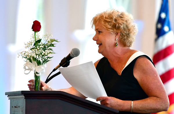 6/5/2019 Mike Orazzi | Staff Bristol Chamber of Commerce President and CEO Cindy Bombard with a rose dedicated to recently passed Sheila Kelly during the 130th Annual Awards Dinner held at the Aqua Turf Club in Southington Wednesday evening.
