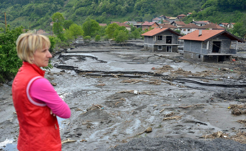 . A resident overlooks the damage done by a landslide at the village of Topcic Polje, near the Bosnian town of Zenica, 90 kilometers north of Sarajevo, Bosnia-Herzegovina Tuesday May 20, 2014.  (AP Photo/Sulejman Omerbasic)