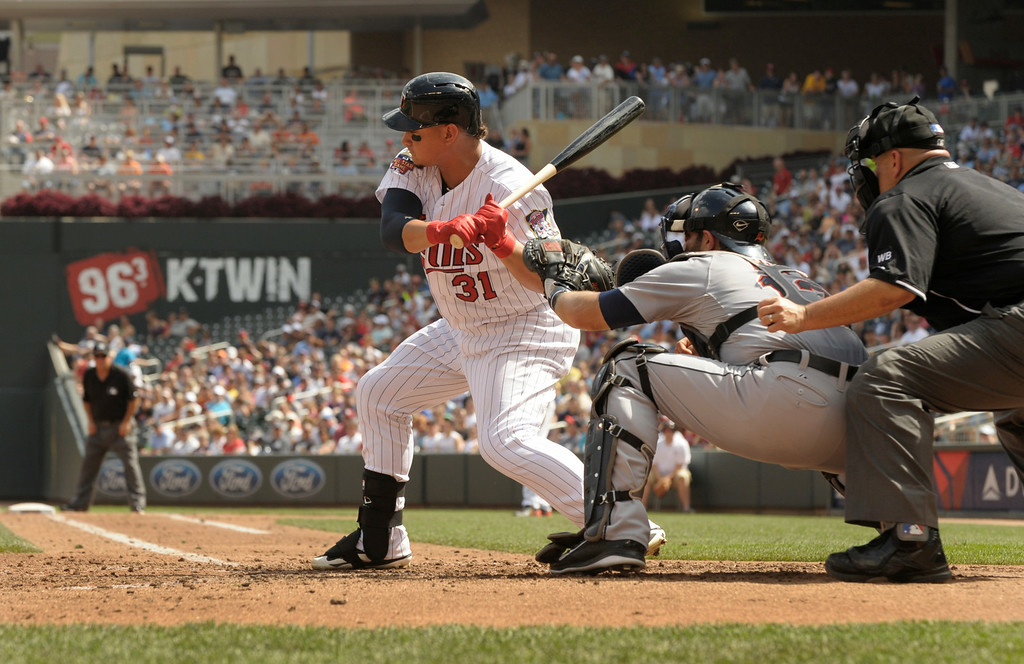 . Minnesota Twins\' Oswaldo Arcia bats against the Detroit Tigers� during  a baseball game in Minneapolis, Sunday, Aug. 24, 2014. (AP Photo/Tom Olmscheid)