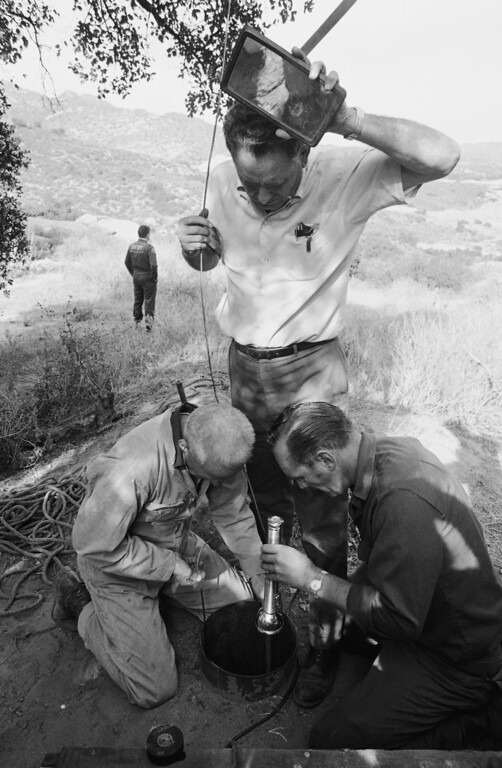". Members of Los Angeles County Sheriff\'s Department search a small well at a movie ranch near suburban Chatsworth, Dec. 11, 1969 in Los Angeles, looking for signs of Donald O\'Shea, a stunt man who has been missing since last August after a reported quarrel with Charles Manson. Manson and five members of his ""family\"" have been charged with the slayings of actress Sharon Tate and seven others. Sheriff\'s deputies searched the ranch Wednesday, but reportedly found no clues. (AP Photo/George Brich)"