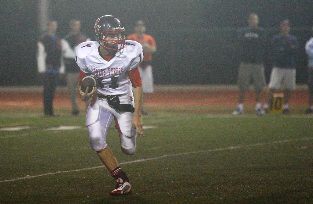 . Quarterback Daniel DiRocco #11 of Palos Verdes runs with the ball against the defense of Mira Costa in a Bay League matchup at Mira Costa High School on Friday, October 18, 2013 in Manhattan Beach, Calif.  (Michael Yanow / For the Daily Breeze)