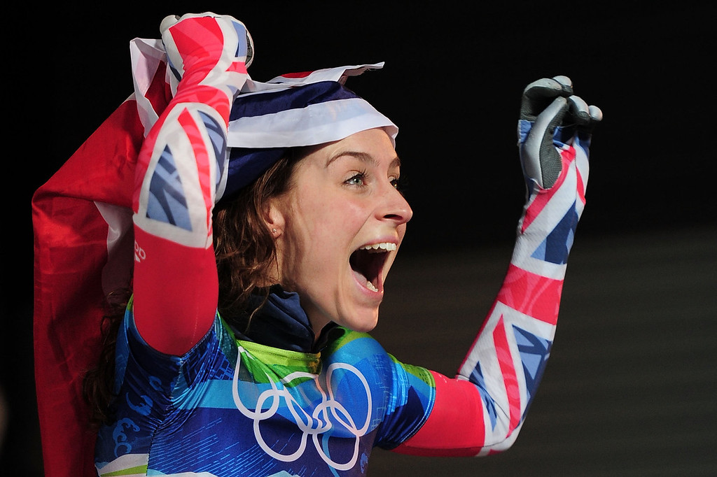 . Amy Williams of Great Britain and Northern Ireland celebrates with her countries flag after she completed her run to win the gold medal in the women\'s skeleton fourth heat on day 8 of the 2010 Vancouver Winter Olympics at the Whistler Sliding Centre on February 19, 2010 in Whistler, Canada.  (Photo by Shaun Botterill/Getty Images)