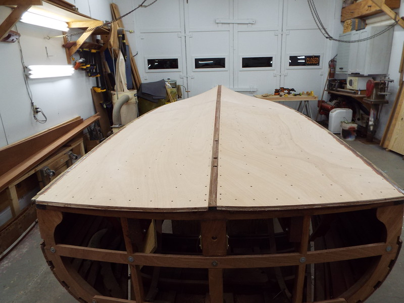 Rear view of the new bottom with the fasteners removed and starting to sand the bottom.