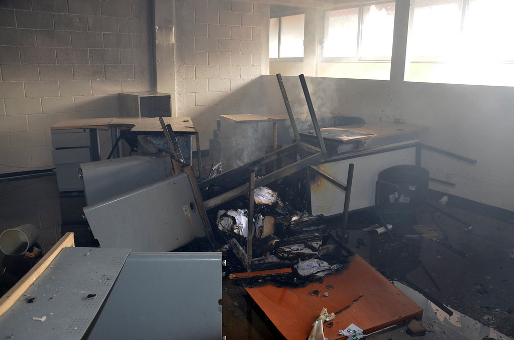. Documents and furniture smolder inside of the state comptroller\'s building after protesters torched the building in the state capital city of Chilpancingo, Mexico, Wednesday Nov. 12, 2014.  (AP Photo/Alejandrino Gonzalez)