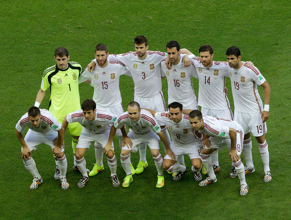 . Spain\'s players pose for a picture prior the group B World Cup soccer match between Spain and the Netherlands at the Arena Ponte Nova in Salvador, Brazil, Friday, June 13, 2014.  (AP Photo/Christophe Ena)