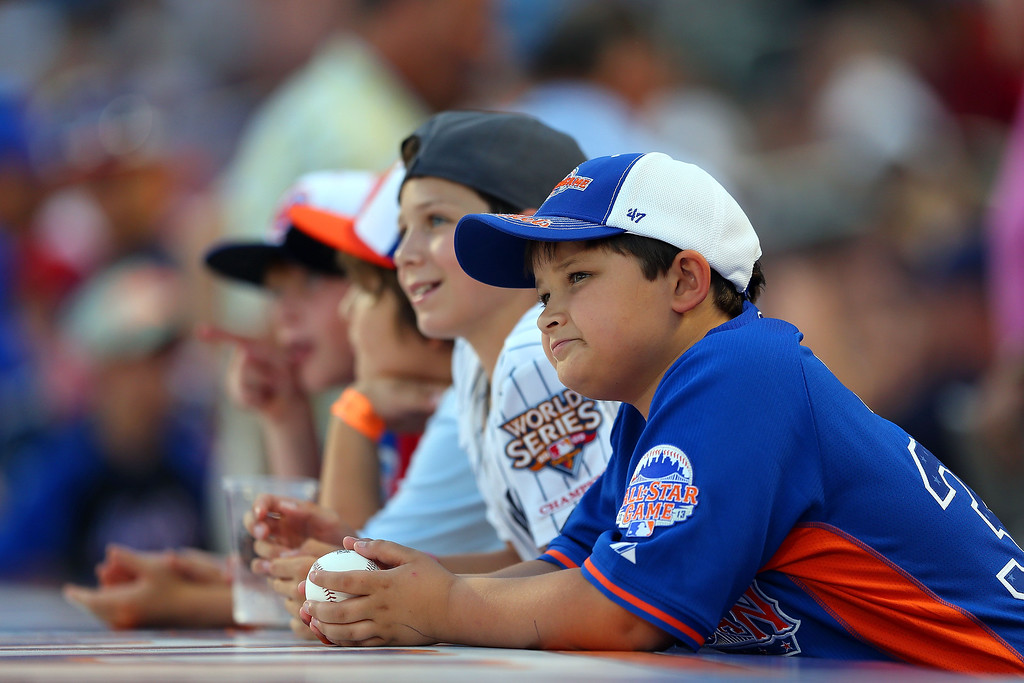 . Young fans wait for autographs during the 84th MLB All-Star Game on July 16, 2013 at Citi Field in the Flushing neighborhood of the Queens borough of New York City.  (Photo by Mike Ehrmann/Getty Images)
