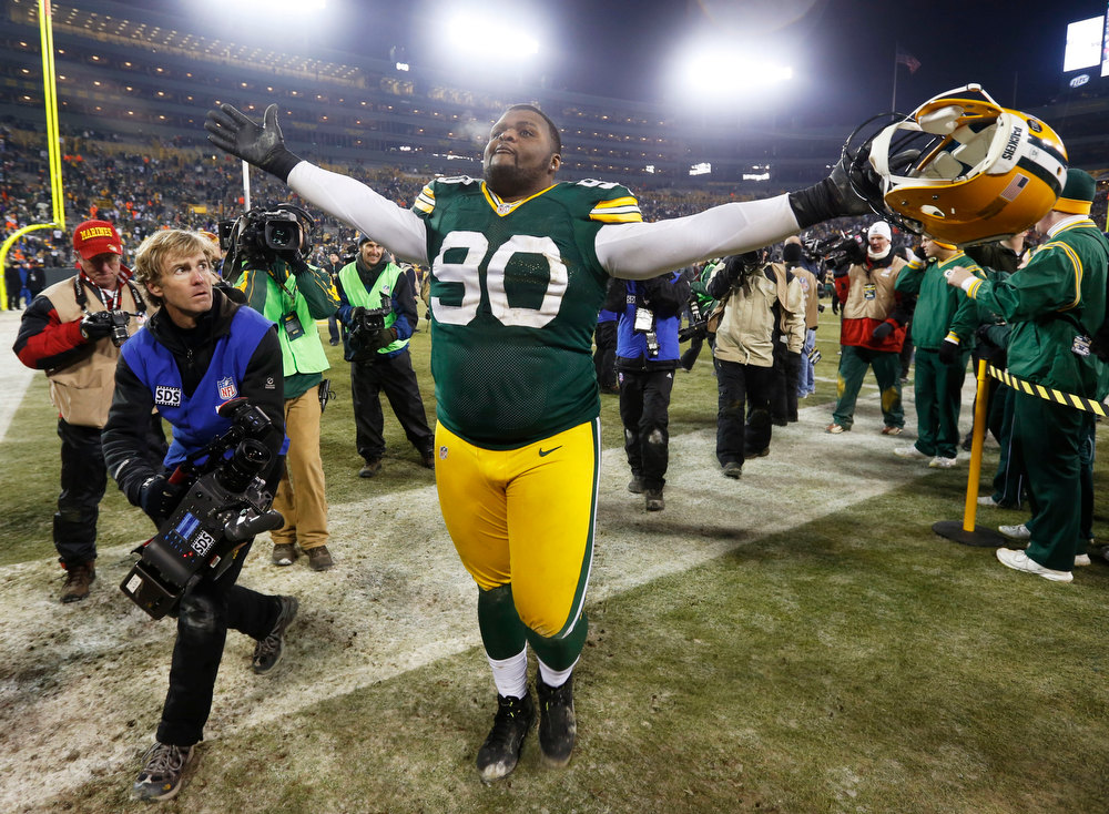 Description of . Green Bay Packers nose tackle B.J. Raji (90) celebrates after an NFL wild card playoff football game against the Minnesota Vikings Saturday, Jan. 5, 2013, in Green Bay, Wis. Packers won 24-10. (AP Photo/Mike Roemer)