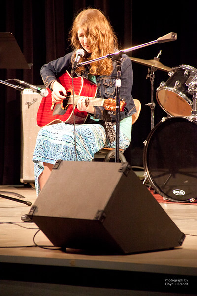 "Havre Daily News/Floyd BrandtThe Salvation held it's annual ""Talent of the Hi-Line"" contest to raise funds for the Salvation Army Saturday. The benefit was held at the Havre High School Auditorium. Katelynn Montagino proved her talent by playing and singing a song that she wrote entitled ""Opal Tree."""