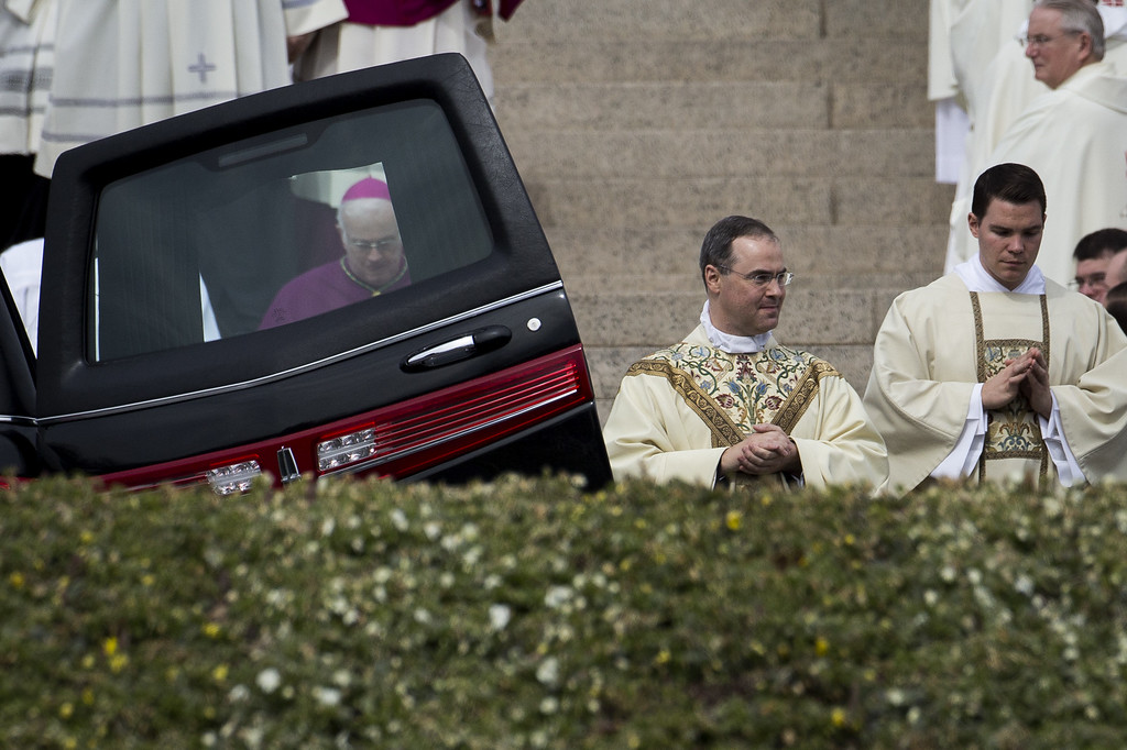 . At center, Father Paul Scalia walks past the hearse at the Basilica of the National Shrine of the Immaculate Conception at the end of the funeral for late Supreme Court justice Antonin Scalia, February 20, 2016 in Washington, DC. Scalia, who died February 13 while on a hunting trip in Texas, laid in repose in the Great Hall of the Supreme Court on Friday and his funeral service will be at the basilica today.  (Photo by Drew Angerer/Getty Images)