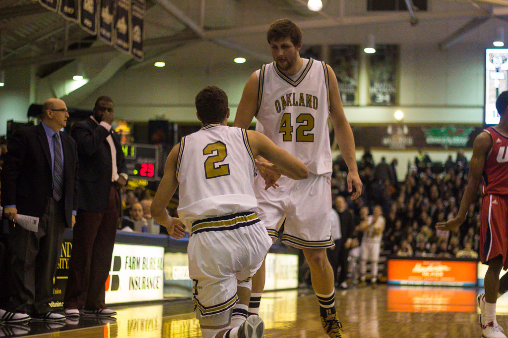 . Petros helps up teammate Williams. Photos by Dylan Dulberg/The Oakland Press