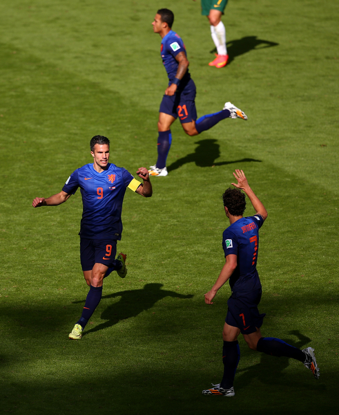 . Robin van Persie of the Netherlands (L) celebrates scoring his team\'s second goal with Daryl Janmaat during the 2014 FIFA World Cup Brazil Group B match between Australia and Netherlands at Estadio Beira-Rio on June 18, 2014 in Porto Alegre, Brazil.  (Photo by Paul Gilham/Getty Images)