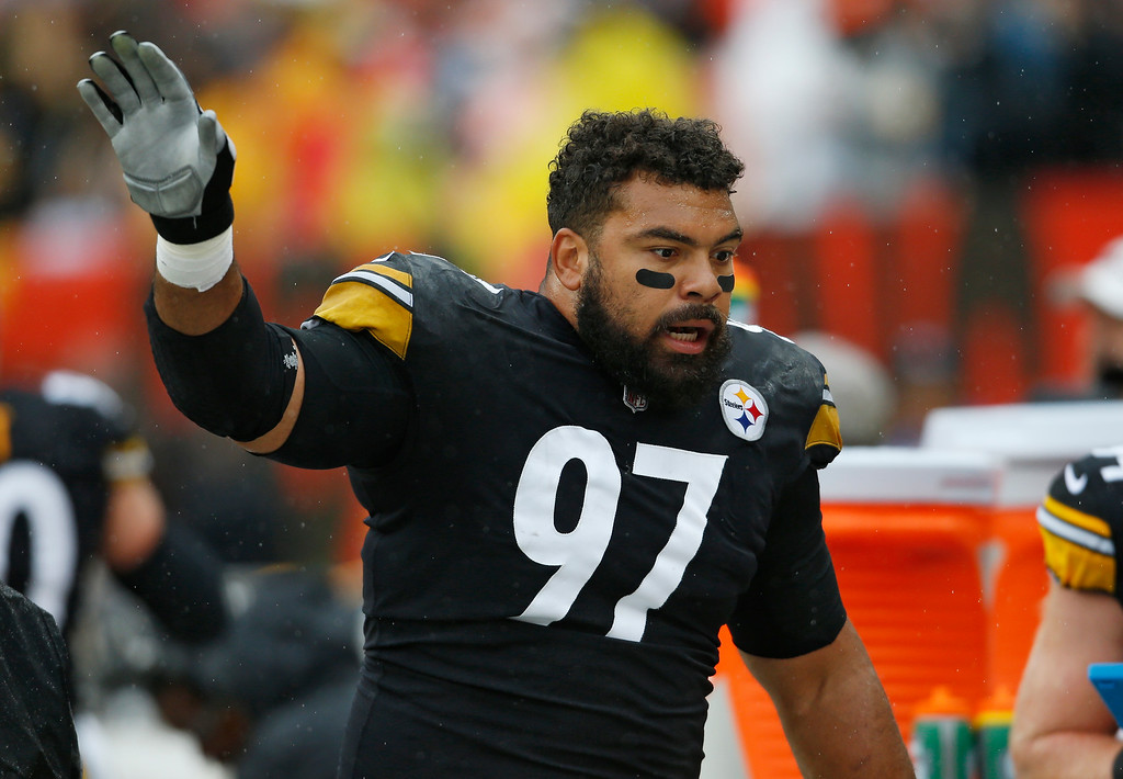 . Pittsburgh Steelers defensive tackle Cameron Heyward talks with teammates during the first half of an NFL football game against the Cleveland Browns, Sunday, Sept. 9, 2018, in Cleveland. (AP Photo/Ron Schwane)