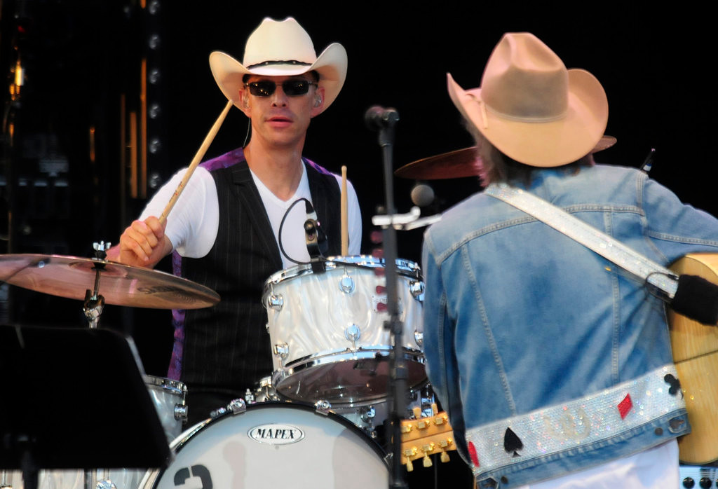 . Dwight Yoakam, right, and his band including  drummer Mitch Marine perform at the Minnesota State Fair Grandstand. (Pioneer Press: Scott Takushi)
