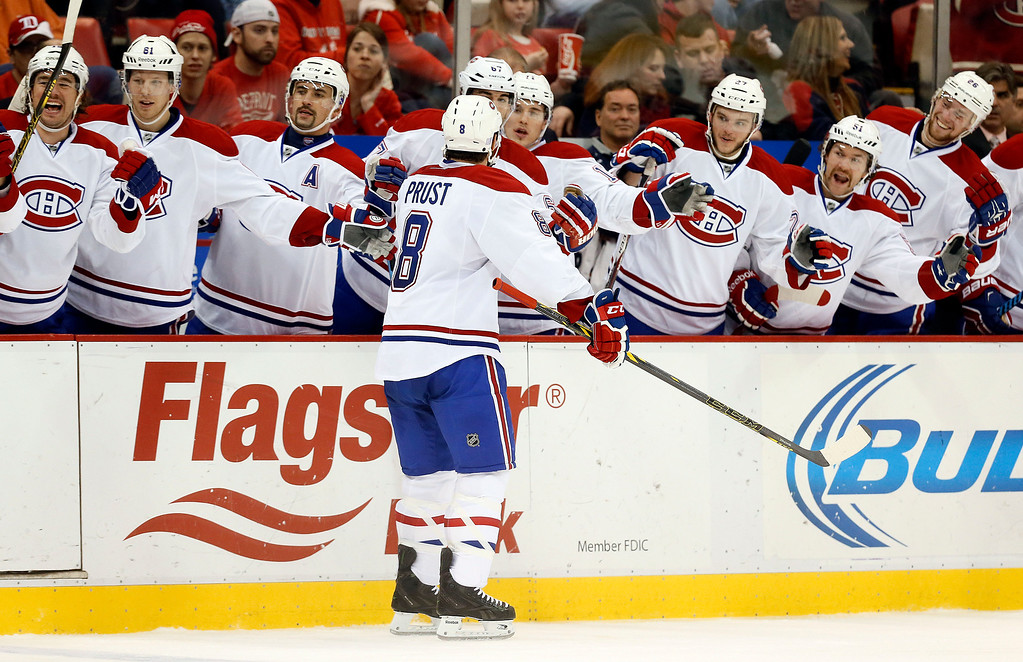 . Montreal Canadiens right wing Brandon Prust (8) celebrates his goal against the Detroit Red Wings with teammates in the second period of an NHL hockey game in Detroit Sunday, Nov. 16, 2014. (AP Photo/Paul Sancya)