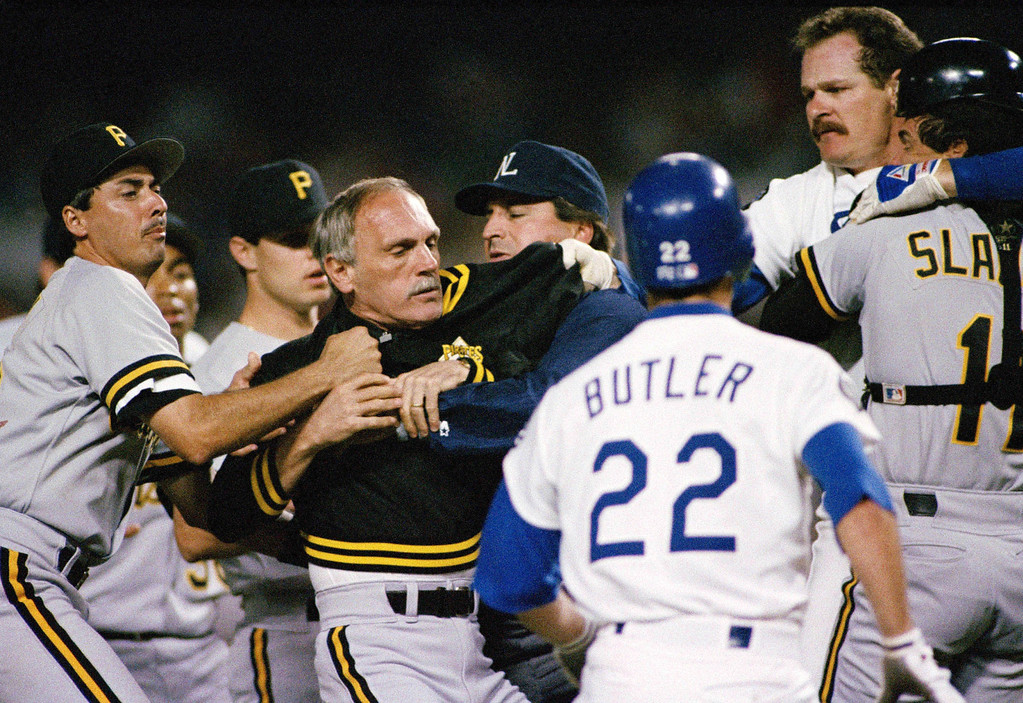 . Pittsburgh Pirates manager Jim Leyland, second from left, is separated from Los Angeles Dodger pitcher Kevin Gross, second from right, during a bench clearing brawl in the third inning Tuesday Aug 24, 1993, in Los Angeles. The fight erupted when Pirates pitcher Bob Walk was thrown of of the game after hitting Gross with a pitch. Leyland was also thrown out of the game. (AP Photo / Eric Draper)