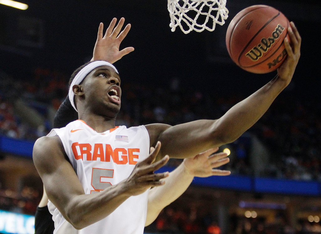 . Syracuse\'s C.J. Fair (5) drives past Western Michigan\'s Connar Tava (2) during the first half of a second-round game in the NCAA college basketball tournament in Buffalo, N.Y., Thursday, March 20, 2014. (AP Photo/Bill Wippert)