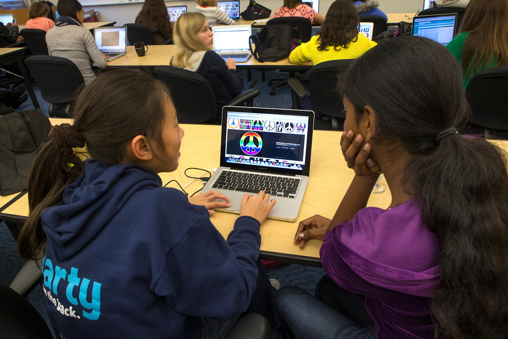 . High School students, from left, Karen Shi and Rashi Raghulan work on project during a mobile gaming app class. (John Green/Staff)