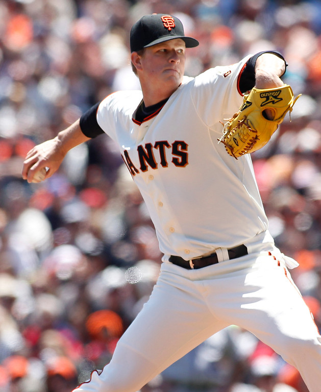 . San Francisco Giants pitcher Matt Cain throws to the Colorado Rockies during the first inning of a baseball game on Sunday, May 26, 2013, in San Francisco. (AP Photo/George Nikitin)