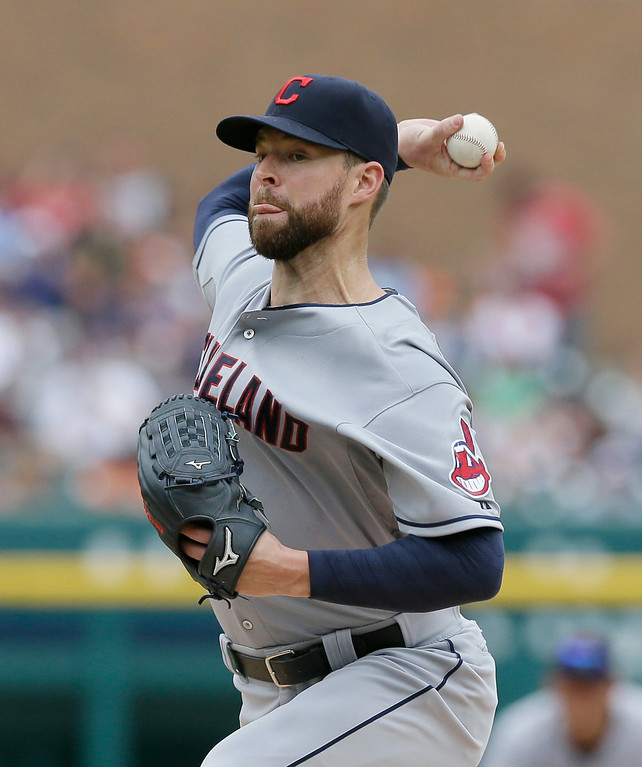 . Cleveland Indians starting pitcher Corey Kluber throws during the first inning in the first baseball game of a doubleheader against the Detroit Tigers, Saturday, July 19, 2014, in Detroit. (AP Photo/Carlos Osorio)