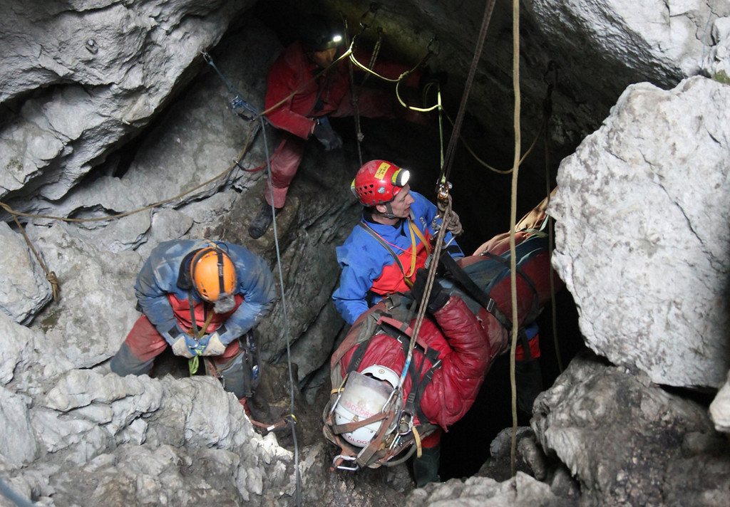 . In this handout photo provided by the Bavarian Mountain Patrol (Bergwacht Bayern), rescue workers bring injured spelunker Johann Westhauser to the surface from the Riesending vertical cave during the final phase of his rescue on June 19, 2014 near Marktschellenberg, Germany. Westhauser received a severe head injury when he was struck by rocks in the cave on June 8, 1,000 meters below the surface, and since then over 700 rescue workers from Germany, Italy, Switzerland, Austria and Croatia have been working around the clock in an arduous effort to save him. Westhauser was among explorers who first discovered the cave, which is over 20 kilometers long, in 1995.  (Photo by Bergwacht Bayern via Getty Images)
