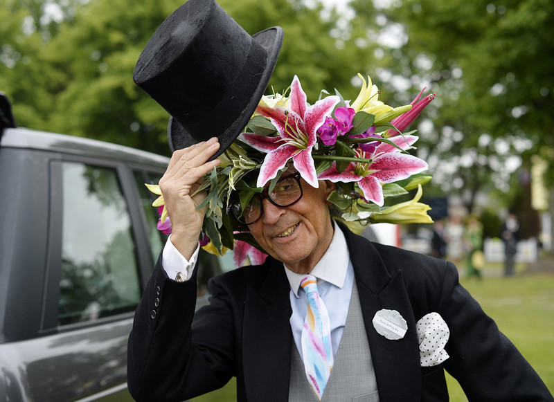 . Milliner David Shilling doffs his hat during the first day of Royal Ascot, in Berkshire, west of London, on June 18, 2013. The five-day meeting is one of the highlights of the horse racing calendar. Horse racing has been held at the famous Berkshire course since 1711 and tradition is a hallmark of the meeting. Top hats and tails remain compulsory in parts of the course while a daily procession of horse-drawn carriages brings the Queen to the course.  ADRIAN DENNIS/AFP/Getty Images