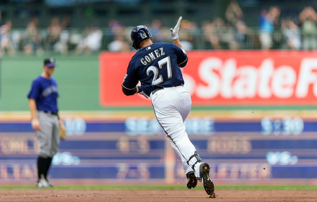 . Carlos Gomez of the Milwaukee Brewers rounds the bases after hitting a two run home run off of Jhoulys Chacin of the Colorado Rockies during the first inning of a baseball game Saturday, June 28, 2014, in Milwaukee. (AP Photo/Tom Lynn)