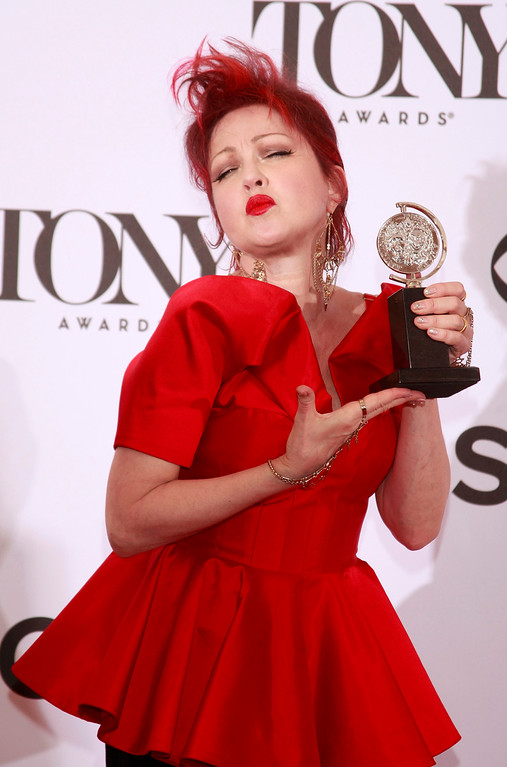". Cyndi Lauper poses with her award for Best Original Score (Music and/or Lyrics) Written for the Theatre for ""Kinky Boots\"" at the American Theatre Wing\'s annual Tony Awards in New York June 9, 2013. REUTERS/Carlo Allegri"
