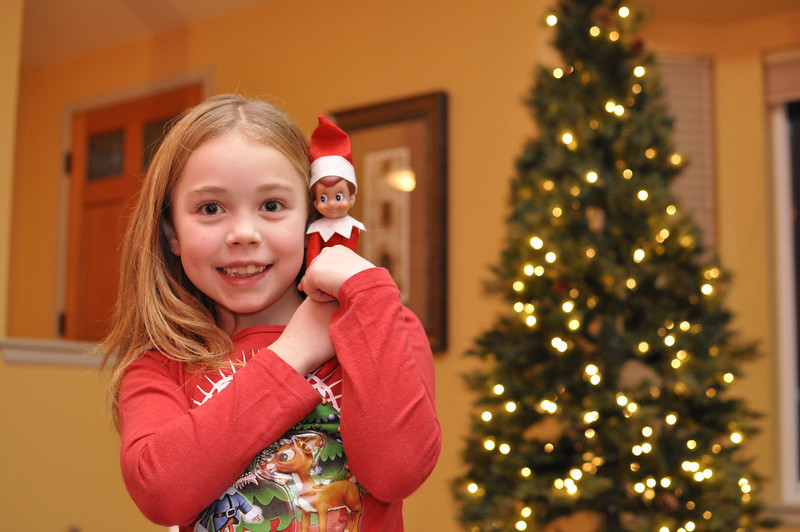 Nov '11 - Kimber holding our new Elf on a Shelf, Ellken.