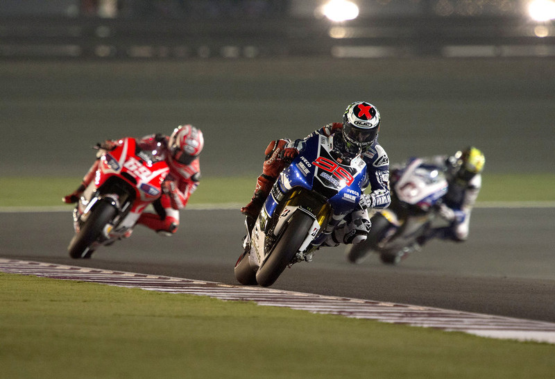 . Jorge Lorenzo of Spain and Yamaha Factory Racing  leads the field during the MotoGp of Qatar - Previews at Losail Circuit on April 4, 2013 in Doha, Qatar.  (Photo by Mirco Lazzari gp/Getty Images)